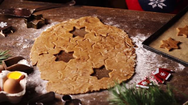 stockvideo's en b-roll-footage met boy cutting dough with star shape cookie cutter - star shape