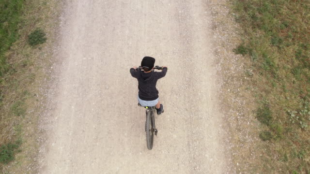 boy cycling, aerial view - 8 9 years stock videos & royalty-free footage