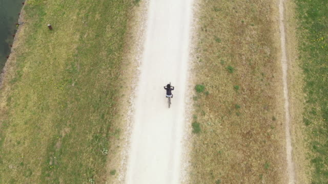 boy cycling along a trail, aerial rear view - 8 9 years stock videos & royalty-free footage