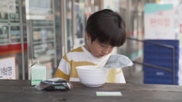 boy doesn't want to eat convenience store food bought with meal service card, seoul, south korea - convenience food stock videos and b-roll footage