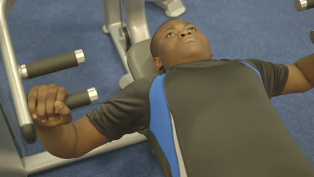 boy doing exercise in gym - bench press stock videos & royalty-free footage