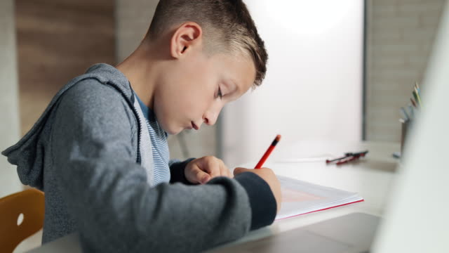boy doing his homework - small stock videos & royalty-free footage
