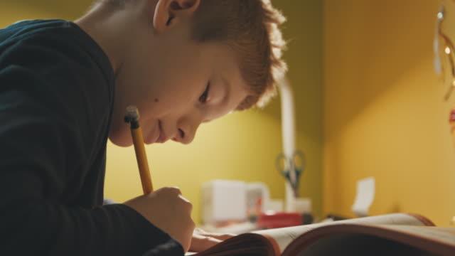 boy doing his math homework - mathematics stock videos and b-roll footage