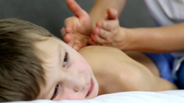 boy doing massage - boy medical exam stock videos and b-roll footage