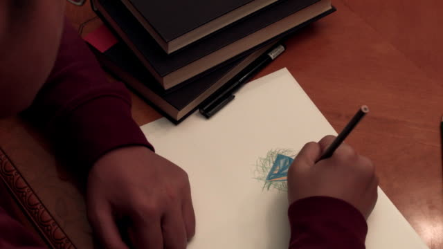 boy drawing art at home for school - un ragazzo adolescente video stock e b–roll