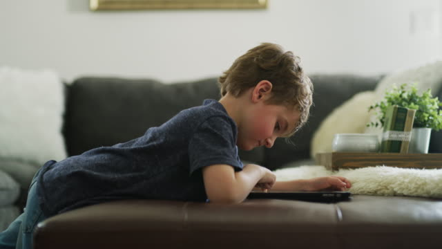 boy drawing on digital tablet then standing and leaving / pleasant grove, utah, united states - preschool student stock videos and b-roll footage