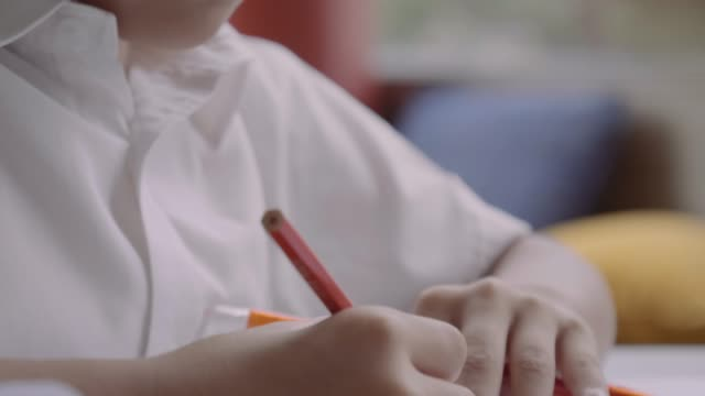 boy drawing on paper at school - colored pencil stock videos and b-roll footage