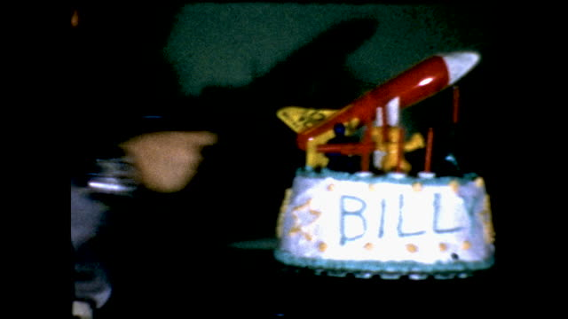 boy dressed as a cowboy unholsters his toy gun and points it at his birthday cake which has his name billy written across the cake. the cake has a... - toy gun stock videos & royalty-free footage
