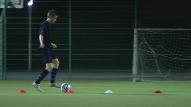 ws ts pan boy (14-15) dribbling ball through cones, london, uk - one teenage boy only stock videos & royalty-free footage