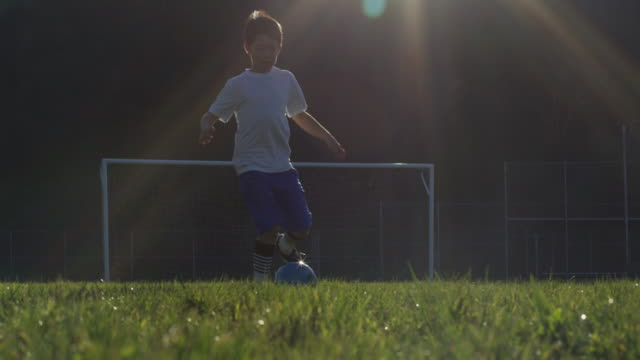 Boy dribbling soccer ball