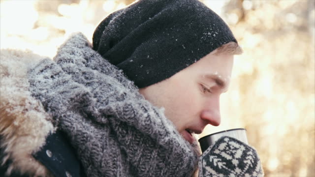 boy drinking hot drink in the forest - warm clothing stock videos and b-roll footage