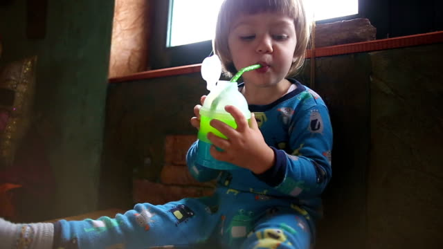 boy drinking juice from green drinking straw - juice drink stock videos and b-roll footage