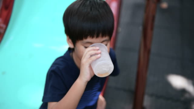 boy drinking water - one teenage boy only stock videos & royalty-free footage