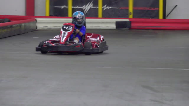 a boy driver races a go kart on a go-kart track. - go cart stock videos & royalty-free footage