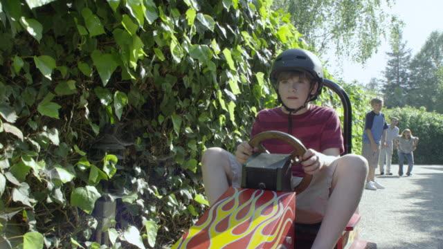 MS POV Boy (10-11) driving toy car on path, Encino, California, USA