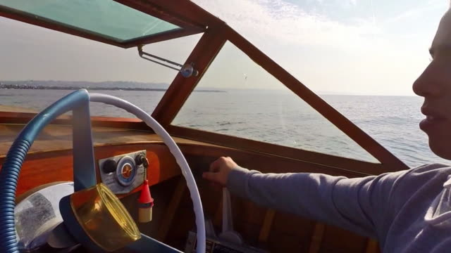boy driving vintage boat - one teenage boy only stock videos & royalty-free footage