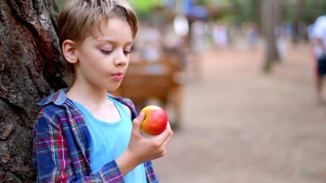 Boy Eating An Apple Close Up