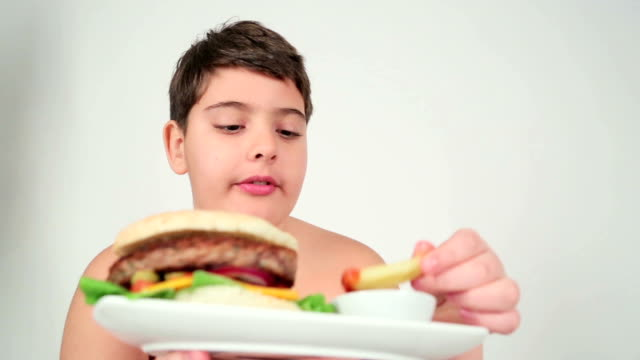 boy eating french fries - overweight child stock videos & royalty-free footage
