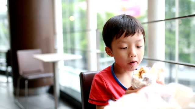 boy eating meal - rice ball stock videos & royalty-free footage