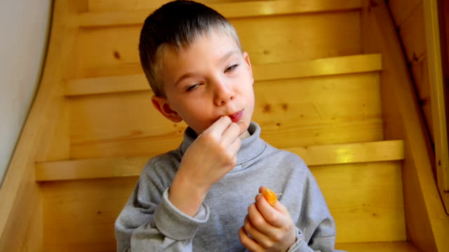 boy eating orange - schoolboy stock videos and b-roll footage
