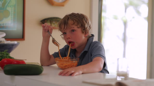 ms boy eating spaghetti / wolfebro, nh, usa        - spaghetti stock videos & royalty-free footage