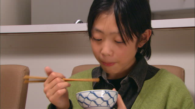 cu, boy (10-11) eating traditional japanese dinner - japanese food stock videos and b-roll footage