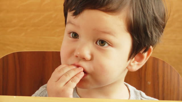 boy eats chocolate v.2 (hd) - candy stock videos & royalty-free footage
