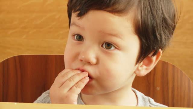 boy eats chocolate v.2 (hd) - chocolate stock videos & royalty-free footage