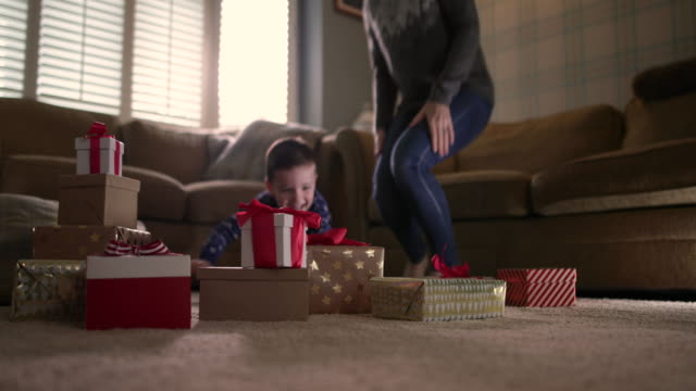 Boy excited on Christmas morning to open presents