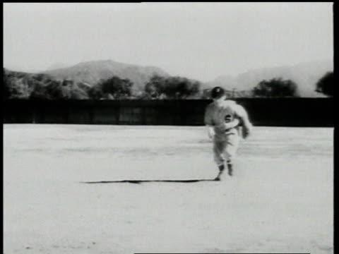 boy fielding a baseball then throwing to base / detroit, michigan, united states - 男児のみ点の映像素材/bロール