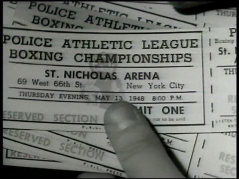 boy fingers holding shuffling police athletic league boxing championship tickets pal - shuffling stock videos and b-roll footage