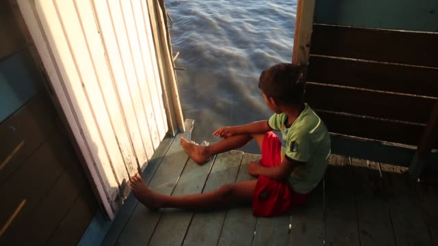 a boy fishes with a makeshift line on november 24 2014 in sao luis brazil - resourceful stock videos & royalty-free footage