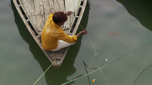 boy fishing from bow of wooden boat from over he'd - one teenage boy only stock videos & royalty-free footage