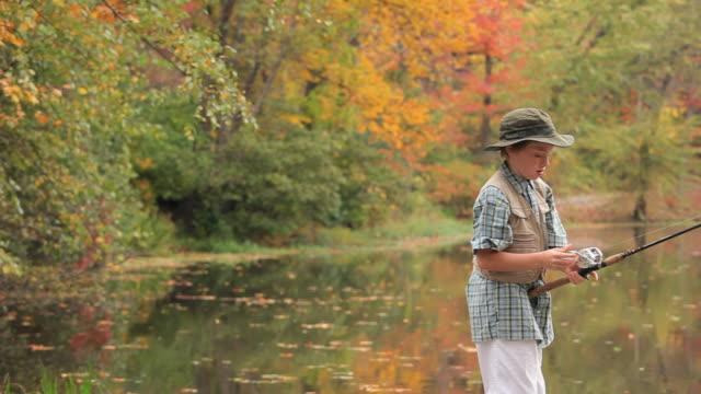 MS PAN Boy (8-9) fishing in lake / Richmond, Virginia, USA