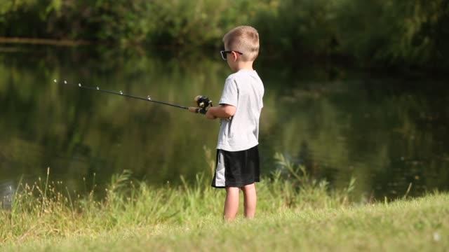 boy fishing - fishing reel stock videos and b-roll footage