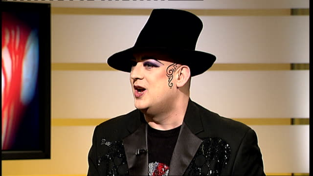boy george live studio interview sot - on how his music is melancholy - talks about dates for his latest tour - ポピュラーミュージックツアー点の映像素材/bロール