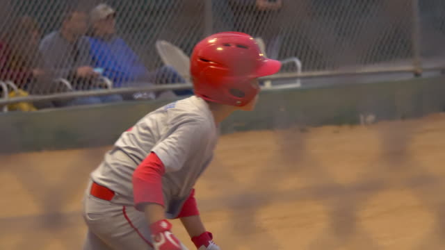a boy gets a base hit batting and playing little league baseball game. - batting stock videos & royalty-free footage