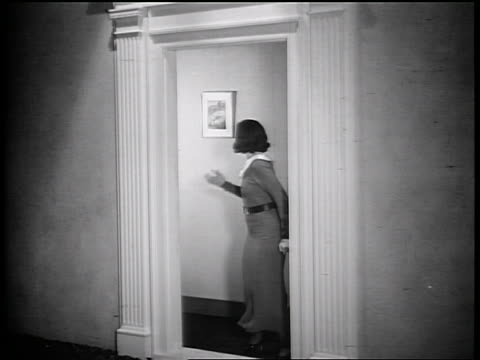 b/w 1935 boy + girl exiting front doorway as parents stand + watch them happily / industrial - 1935 stock videos & royalty-free footage