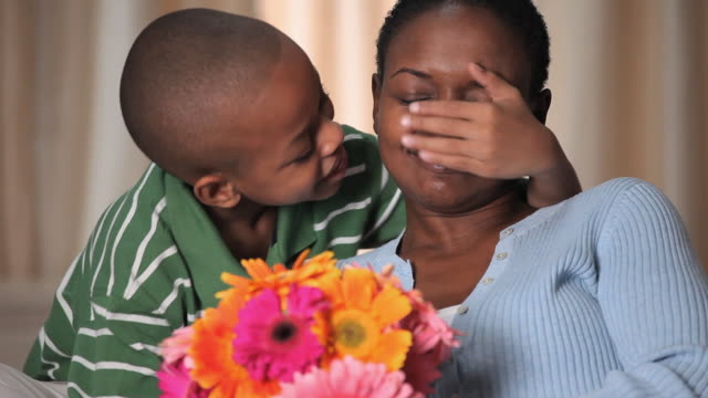 cu boy (8-9) giving flowers to mother for mother's day / richmond, virginia, usa - giving stock videos & royalty-free footage