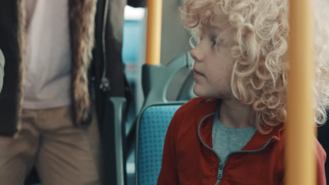 boy giving his place to grandpa in the bus - seat stock videos & royalty-free footage