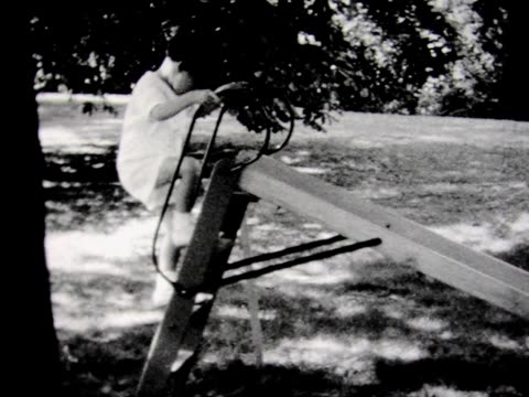 1934 boy going down small slide - 1934 stock videos & royalty-free footage