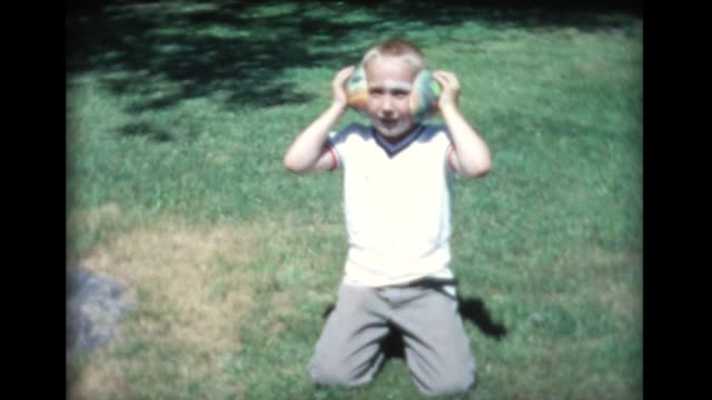 1961 boy goofing around with rubber ears