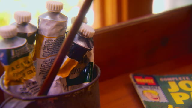 boy grabbing colored pencil, then paint tube from jar, extreme close up - colored pencil stock videos and b-roll footage