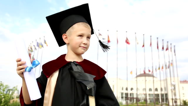 boy graduate - mortar board stock videos & royalty-free footage