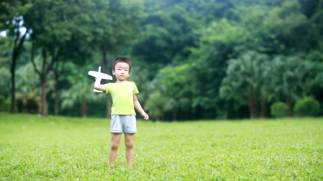 boy hand holding a paper plane,hd slow motion - gliding stock videos and b-roll footage