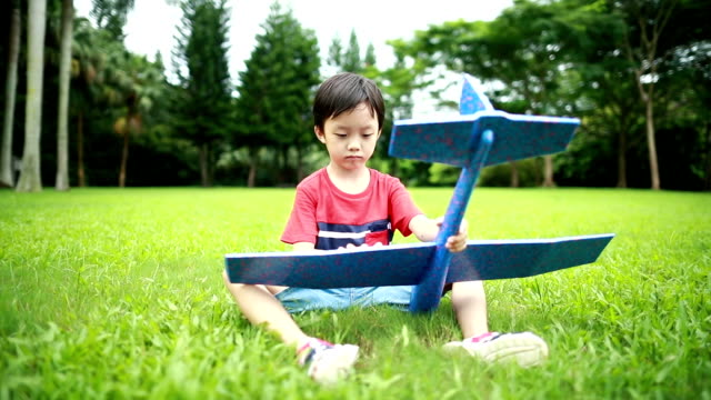 boy hand holding a paper plane,hd slow motion - model aeroplane stock videos & royalty-free footage