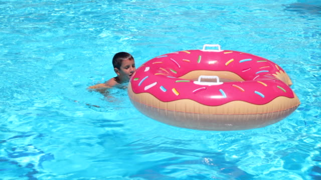 boy having fun in swimming pool, hanheld shot - capsizing stock videos and b-roll footage