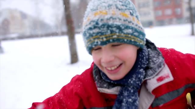 Boy having fun on the playground in winter