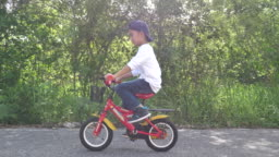 Boy having fun while riding a bicycle in slow motion