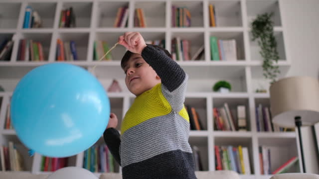 boy having fun with balloon - medium group of objects stock videos & royalty-free footage